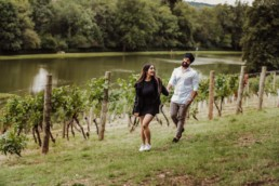 Couple near a river at the Painshill Park Surrey engagement shoot